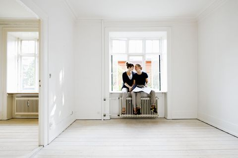 Couple sitting in window of new home
