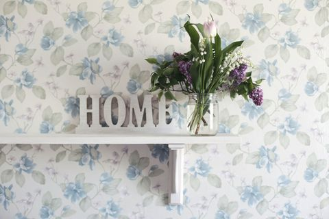 Flower Vase On Shelf At Home with Sign