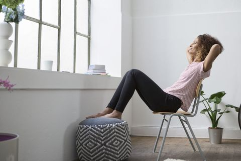 Woman sitting in chair daydreaming