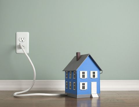 Mini house plugged into the mains electric