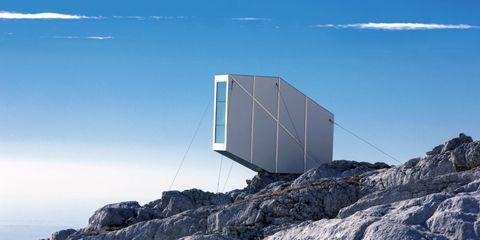 Sky, Architecture, Mountain, Landscape, Mountain range, Rock, Vehicle,