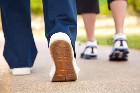 Closeup of Walker's Shoes on a Pathway
