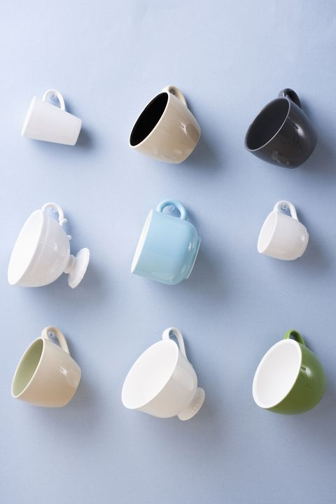 Hanging teacups on blue wall