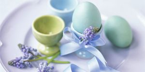 Coloured eggs, eggcups and grape hyacinths