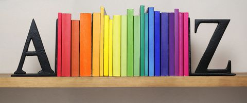 Rainbow bookshelf with colourful books