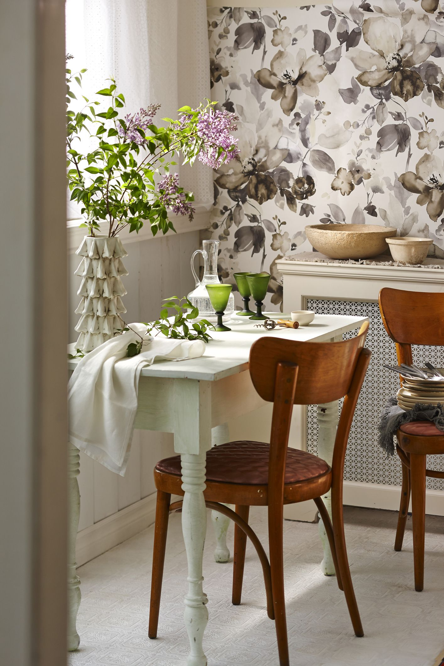 Rustic Dining Room With Table Setting And Chairs