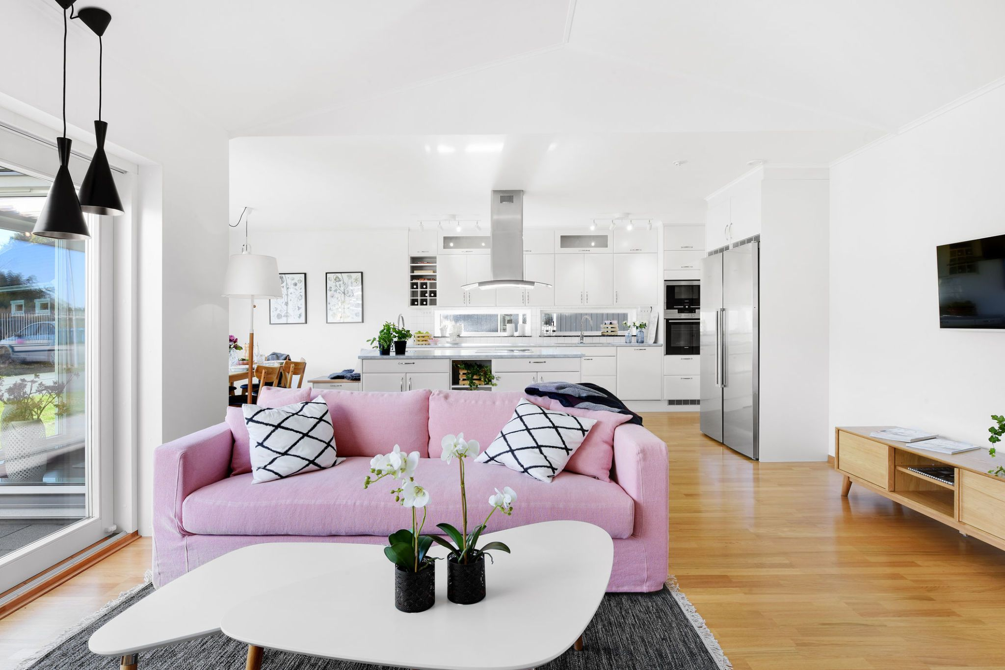 Interior of modern living room with pink sofa & How to plan a room layout and make the best use of space