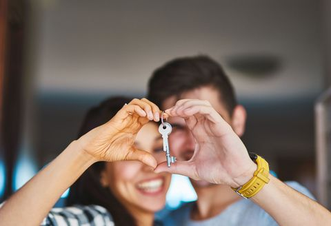 Homeowning couple with their house key