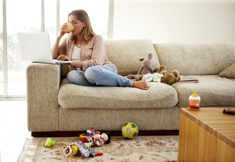 Woman working from home in messy environment