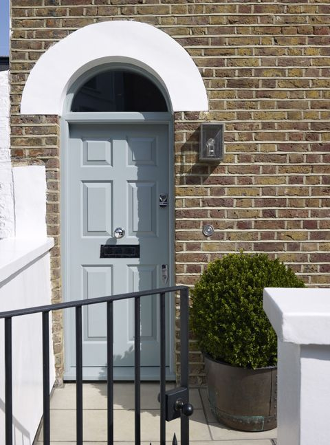 Pale Blue Front Door In Brick House