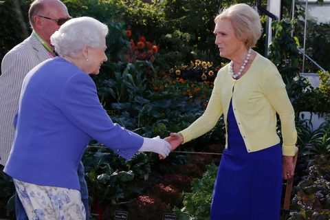 Britain's Queen Elizabeth greets celebrity chef Mary Berry on the BBC Radio 2 Feel Good Gardens at the RHS Chelsea Flower show in London Monday May 22, 2017.