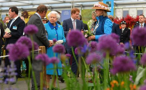 Queen Elizabeth II and Prince Harry attend the annual Chelsea Flower show, 2015