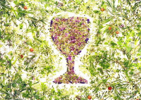 Wine glass made up of herbs and flowers