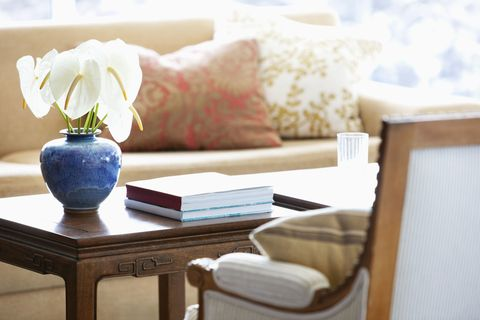 Anthuriums in vase on coffee table