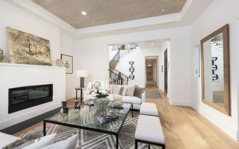 "<p>The three-story house, which was listed with <a href=""https://www.hiltonhyland.com/associates/susan-smith/#agent-properties"" target=""_blank"" data-omtag=""web:article:content:link"">Susan Smith</a> of Hilton &amp; Hyland, also includes a dining room that seats 12 people.</p>"
