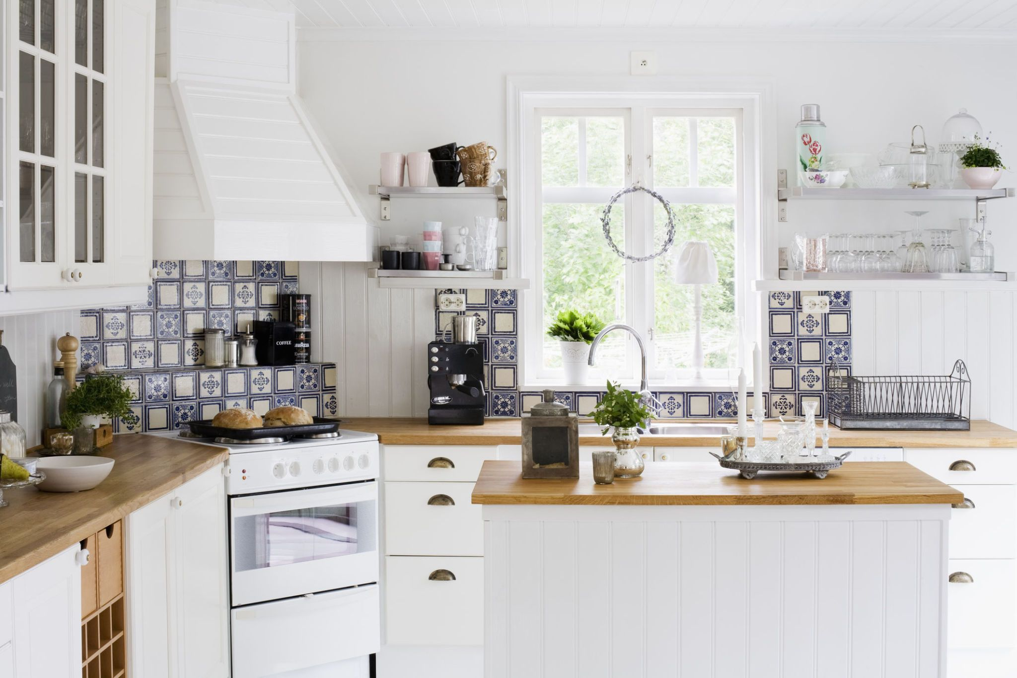 Sweden Contemporary kitchen with white furniture & 5 steps to creating a Scandinavian kitchen