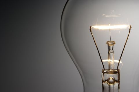 Close-up shot of illuminated light bulb