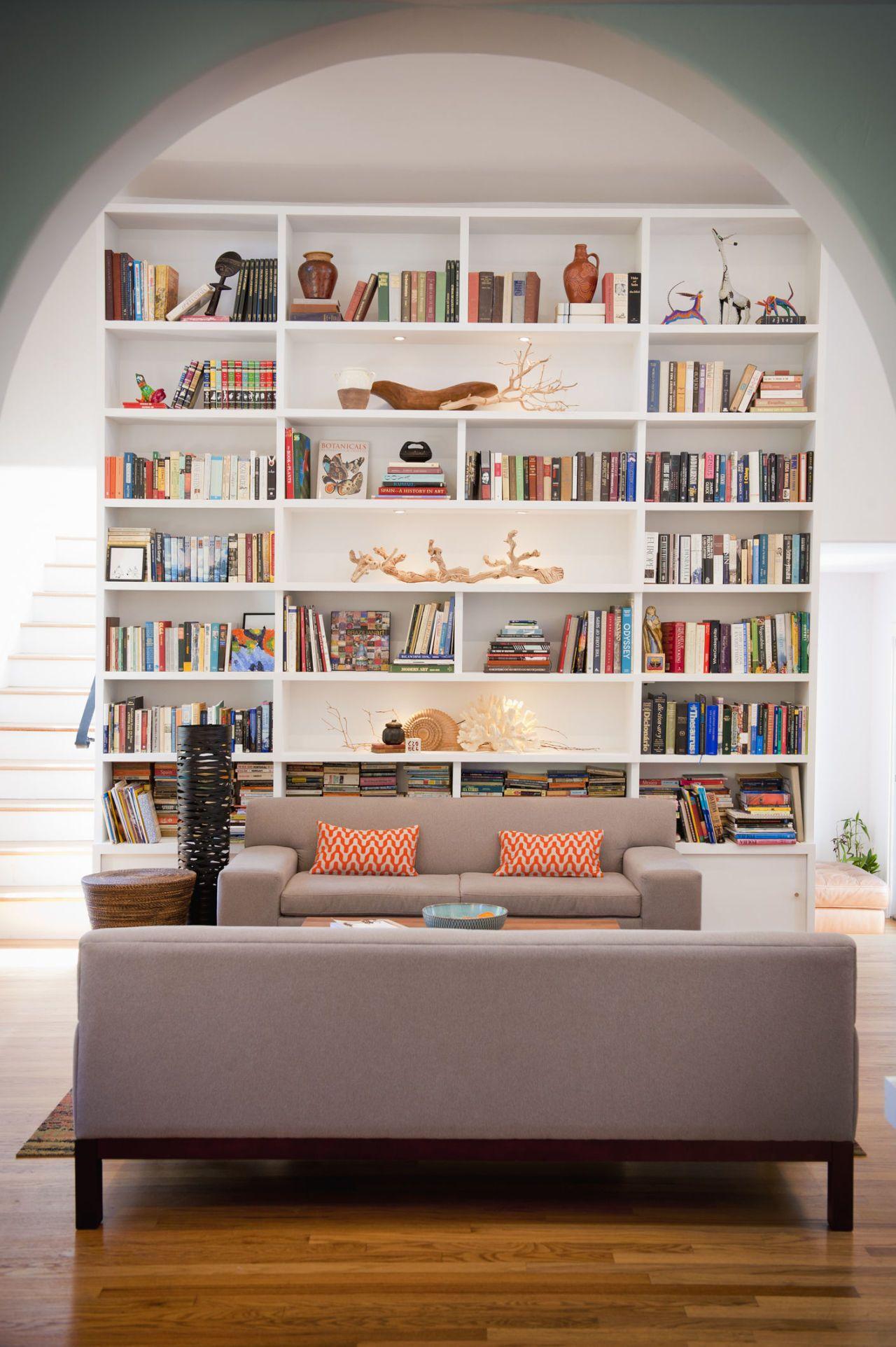 Light Filled Living Room With Tall Bookshelves