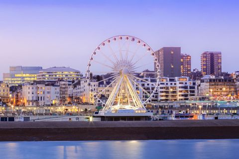 Brighton and Hove, Brighton, Palace (Brighton) Pier, view of the beach and Brighton Wheel from the pier
