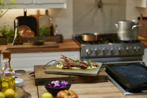 Prawns on a kitchen counter: Grilled prawns in a rustic kitchen setting