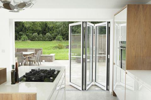 Kitchen with open patio doors