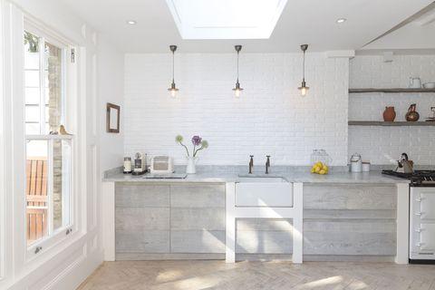 White, Room, Furniture, Tile, Property, Countertop, Floor, Kitchen, Interior design, Cabinetry,
