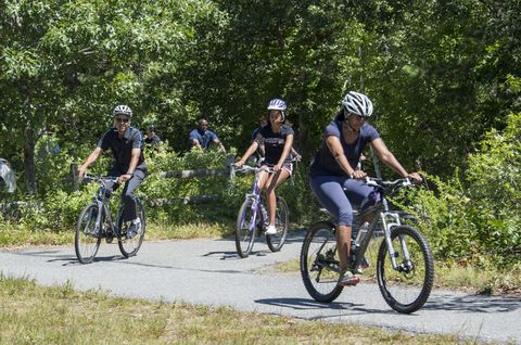 <p>Here, President Obama, Michelle Obama and Malia Obama ride bikes in West Tisbury, on Martha's Vineyard on August 15, 2014.</p>