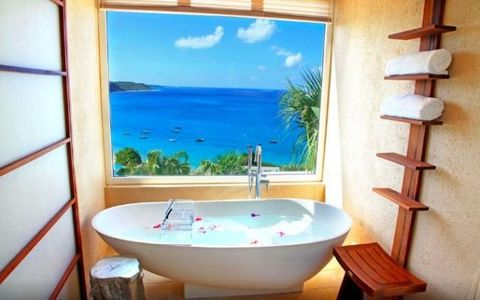 "<p>This <a href=""https://www.expedia.co.uk/Anguilla-Hotels-CeBlue.h8316755.Hotel-Information"" data-href=""https://www.expedia.co.uk/Anguilla-Hotels-CeBlue.h8316755.Hotel-Information"" target=""_blank"">villa on the Caribbean island of Anguilla</a> comes with a private beach and full-service spa. But, really,  you could just spend your entire time in that rose petal-filled bath tub overlooking the Caribbean sea.</p>"
