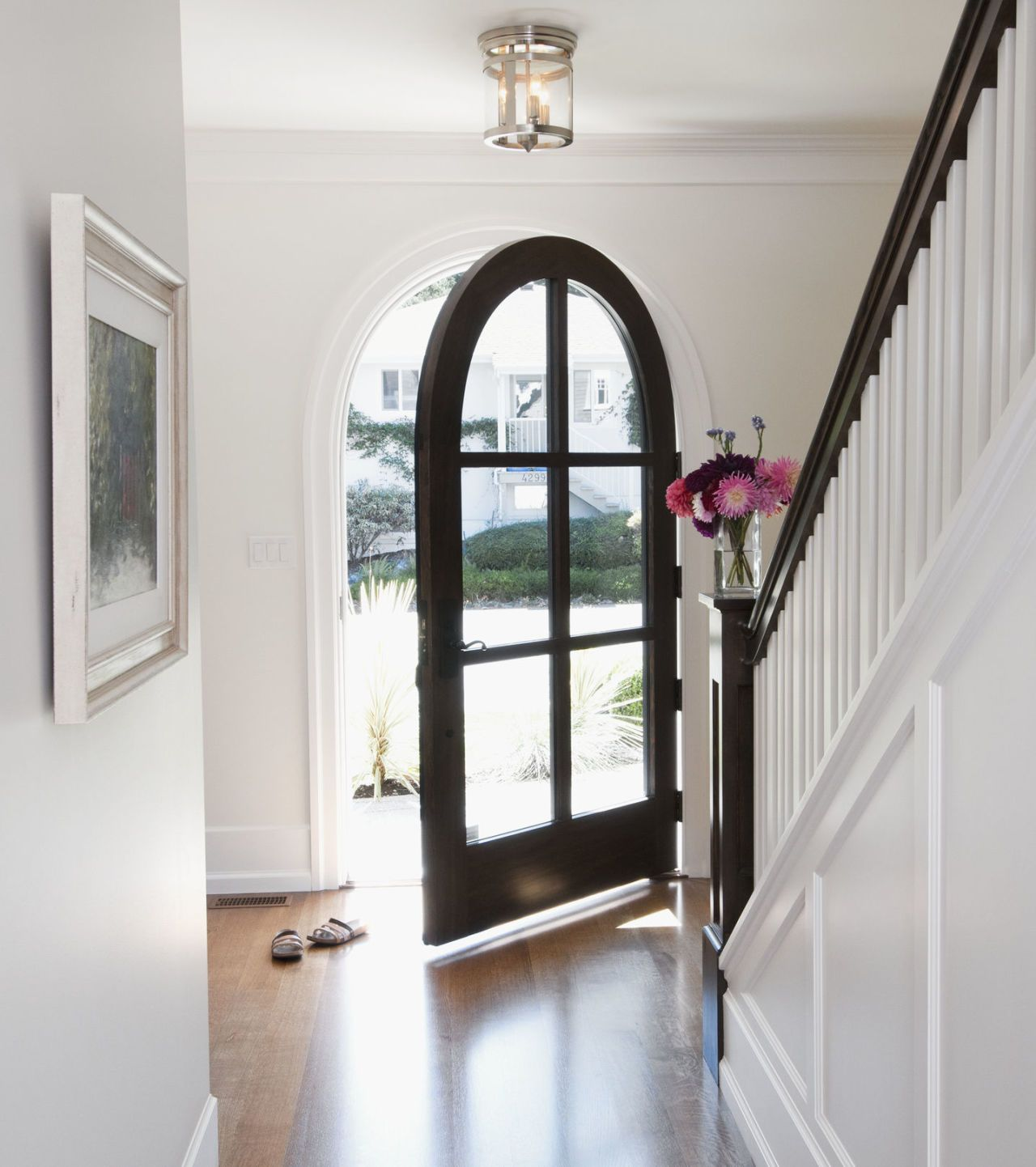 An Arched Doorway Opens To Hallway
