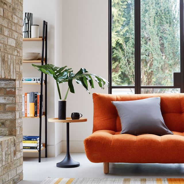 orange sofa living room design   habitat and topology interiors   small space living