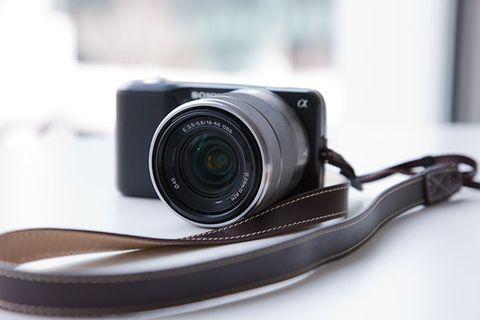 Camera accessory, Point-and-shoot camera, Cameras & optics, Camera lens, Camera, Digital camera, Product, Lens, Mirrorless interchangeable-lens camera, Strap,