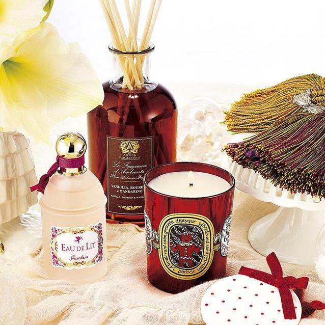 Perfume, Peach, Petal, Bottle, Glass bottle, Beige, Household supply, Ingredient, Cosmetics, Costume accessory,