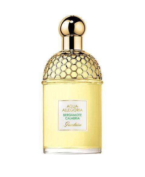 Perfume, Yellow, Glass bottle, Bottle, Liquid, Amber, Fluid, Metal, Beige, Cosmetics,
