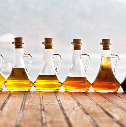 Glass bottle, Bottle, Liqueur, Drink, Yellow, Liquid, Alcohol, Distilled beverage, Palm oil, Barware,