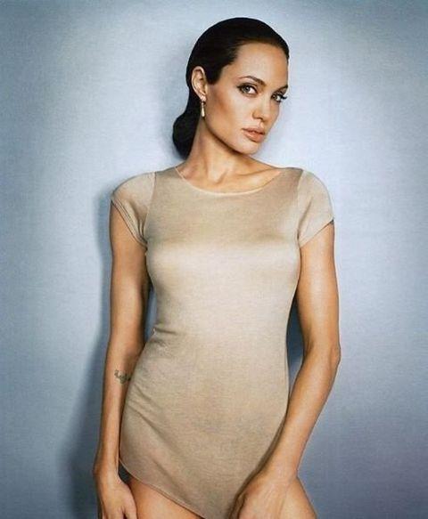Clothing, Fashion model, Shoulder, Skin, Leotard, Beauty, Neck, Sportswear, Model, Fashion,
