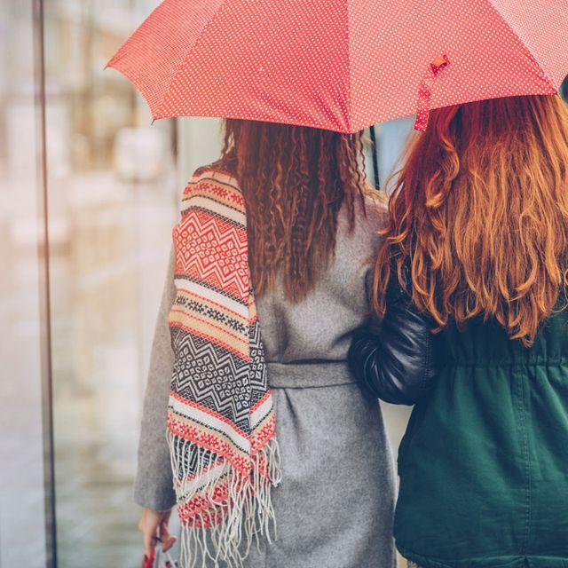 Red, Photograph, Umbrella, Street fashion, Yellow, Beauty, Snapshot, Outerwear, Human, Rain,