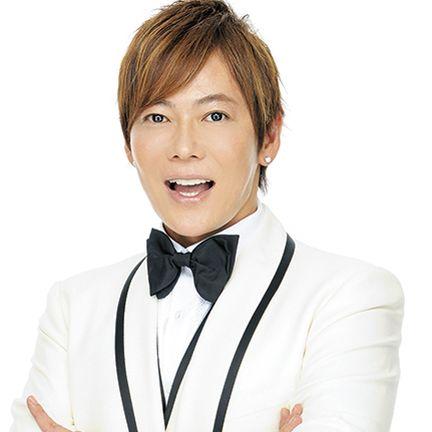 White-collar worker, Tie, Neck, Formal wear, Smile, Suit, Gesture, Tuxedo,
