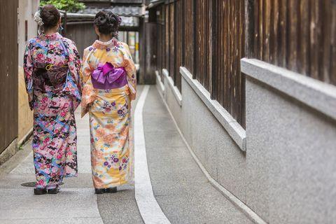 Kimono, Clothing, Dress, Costume, Yellow, Fashion, Street fashion, Sari, Temple, Plant,