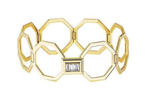 Yellow, Metal, Fashion accessory, Symmetry, Brass, Logo, Jewellery, Gold,