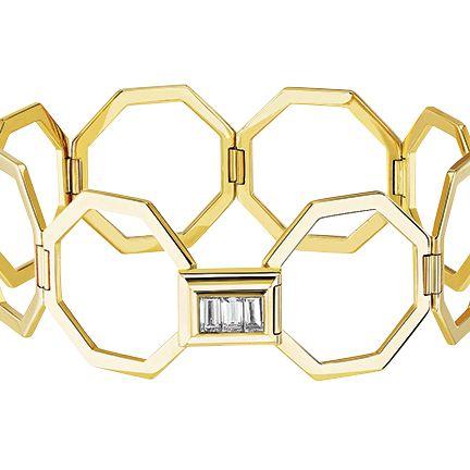 Yellow, Metal, Fashion accessory, Symmetry, Logo, Brass, Jewellery,