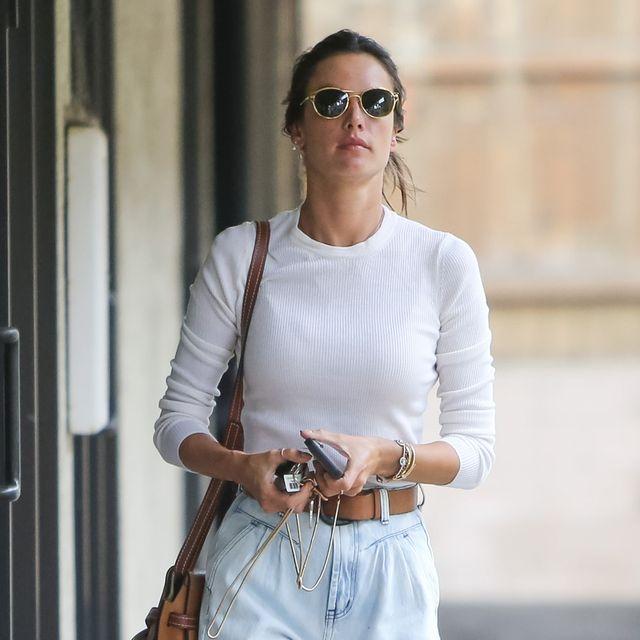 White, Clothing, Street fashion, Eyewear, Shoulder, Fashion, Sunglasses, Waist, Jeans, Sleeve,
