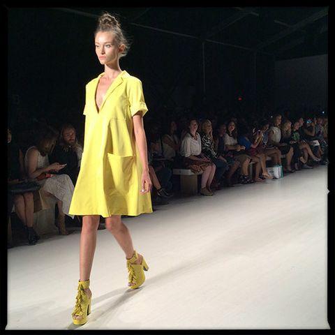 Clothing, Human, Yellow, Fashion show, Shoulder, Joint, Runway, Style, Fashion model, Dress,