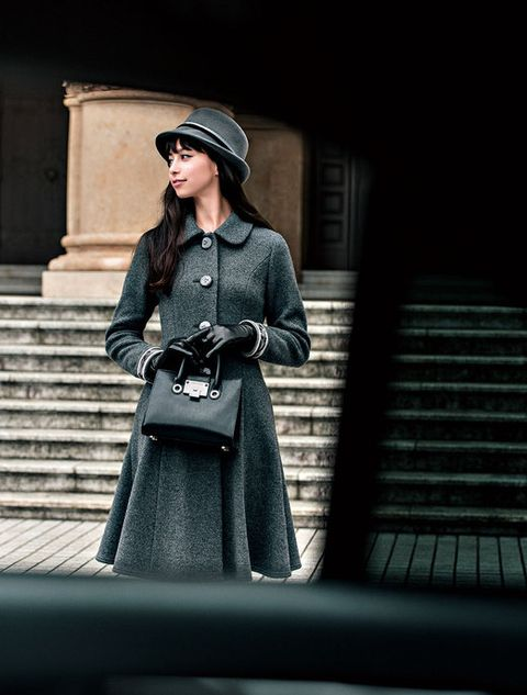 Clothing, Hat, Sleeve, Coat, Outerwear, Standing, Style, Street fashion, Dress, Fashion accessory,