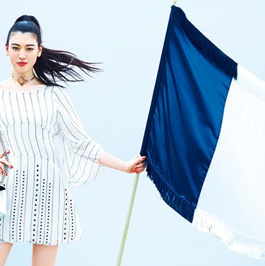 Blue, Finger, Sleeve, Flag, Textile, Dress, Beauty, One-piece garment, Fashion, Electric blue,