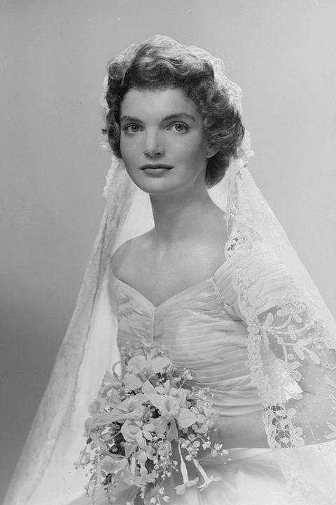 Clothing, Bridal clothing, Shoulder, Eyebrow, Photograph, White, Bridal accessory, Dress, Wedding dress, Bridal veil,