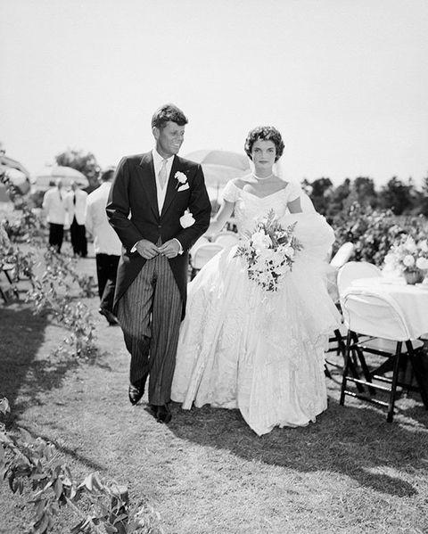 People, Coat, Dress, Trousers, Bridal clothing, Petal, Suit, Photograph, Outerwear, White,