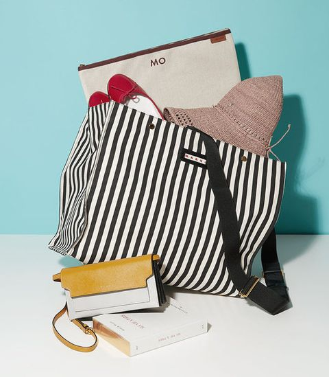 Textile, Bag, Teal, Wallet, Paper product, Throw pillow, Cushion, Paper, Home accessories, Shoulder bag,