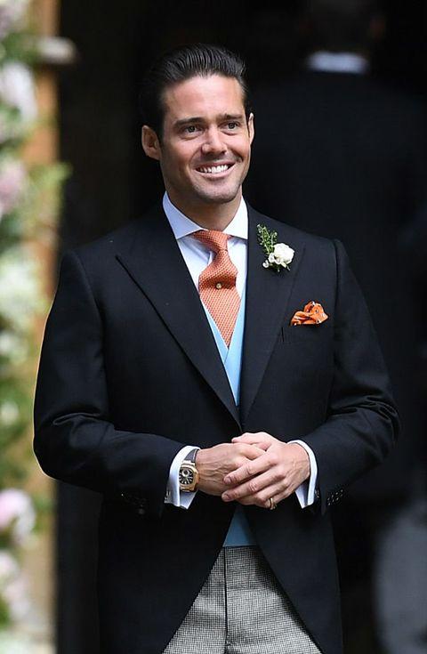 Suit, Formal wear, Tuxedo, White-collar worker, Blazer, Businessperson, Event, Gesture, Official, Smile,