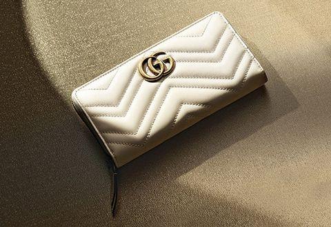 Logo, Font, Wallet, Beige, Fashion accessory, Brand, Button,