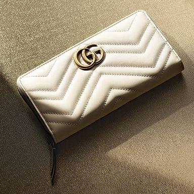 Logo, Wallet, Font, Beige, Fashion accessory, Button, Brand,